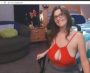 Nerdy babe with glasses showing unbelievable natural boobs